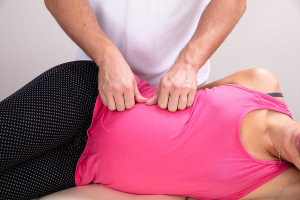 Chiropractor treating pregnant woman